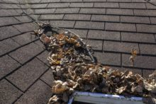 cleaning your gutters 220x147 5 Steps for Maintaining Your Roof!